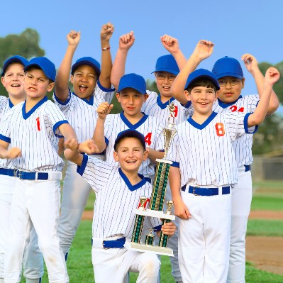Cheering Little League Champions --- Image by © Royalty-Free/Corbis