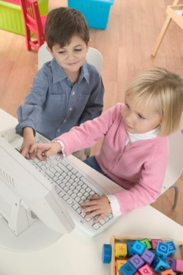 Boy Helping Girl Use Computer November 24, 2003