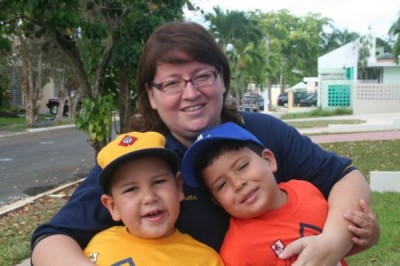 Álvaro como tigre (6 años), Diego como Lobo (7 años) y yo como líder de Tigres.
